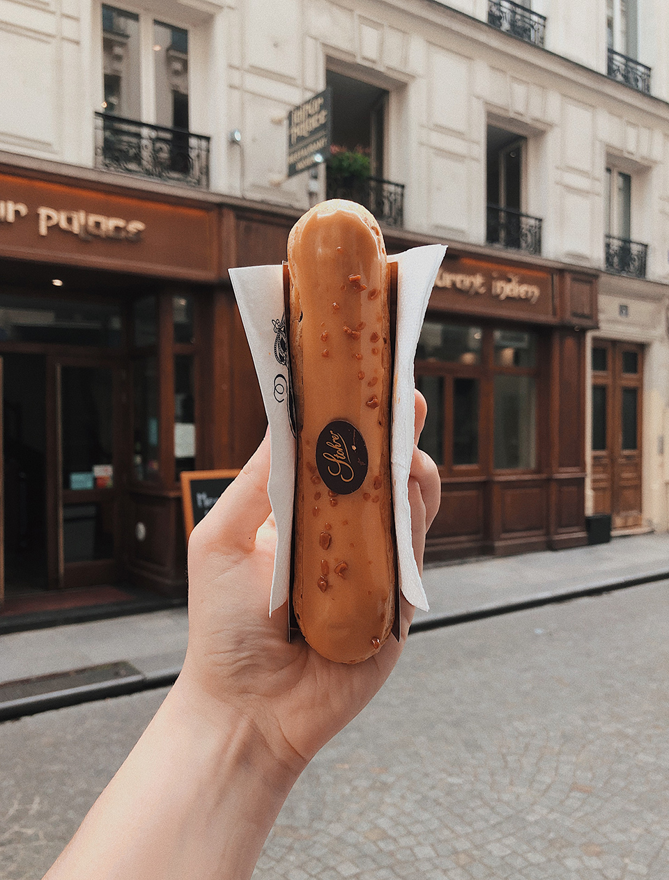An salted caramel eclair bought at Stohrer in Paris