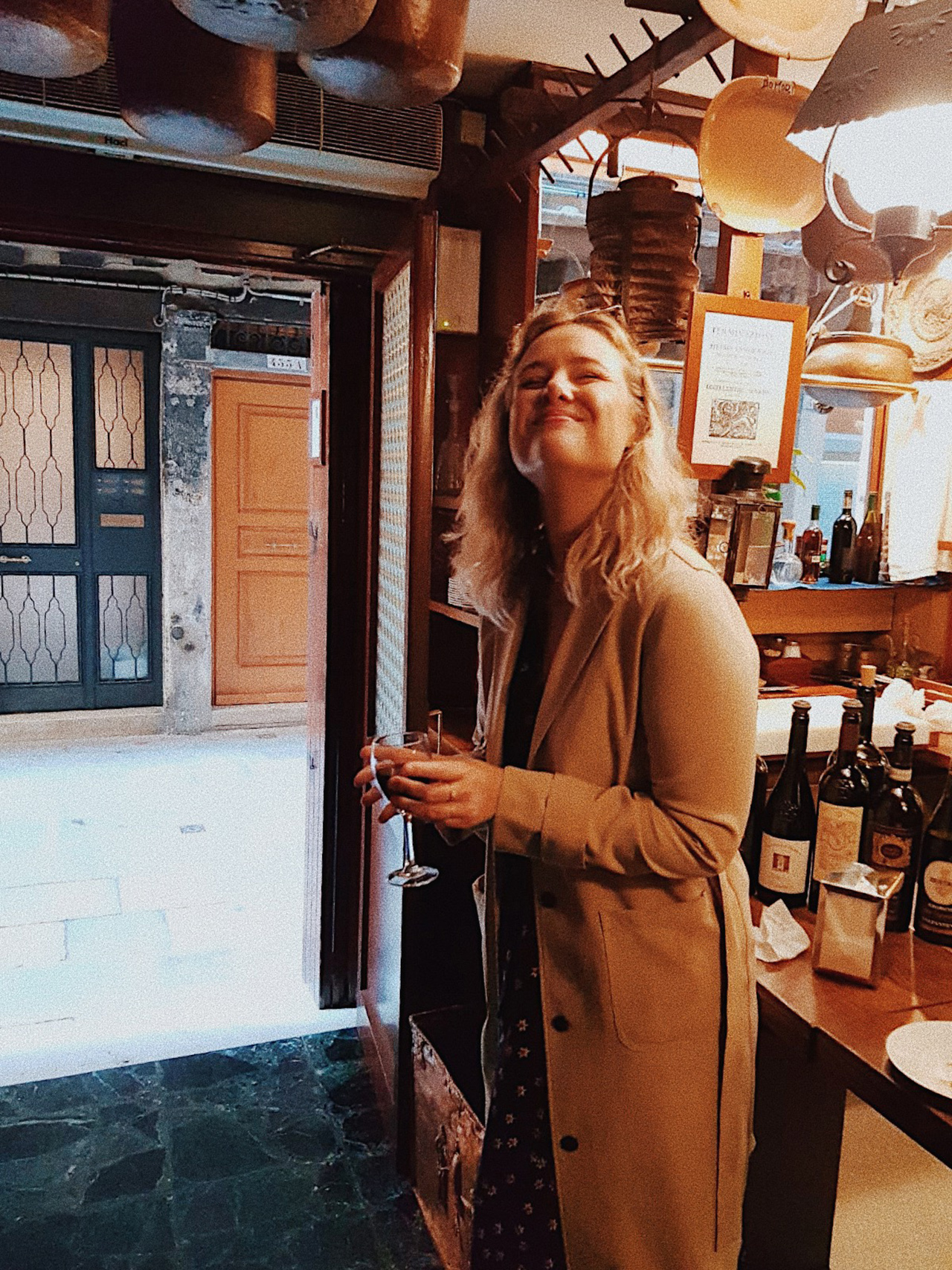 Blogger Sarah Witpeerd at wine bar in Venice Italy